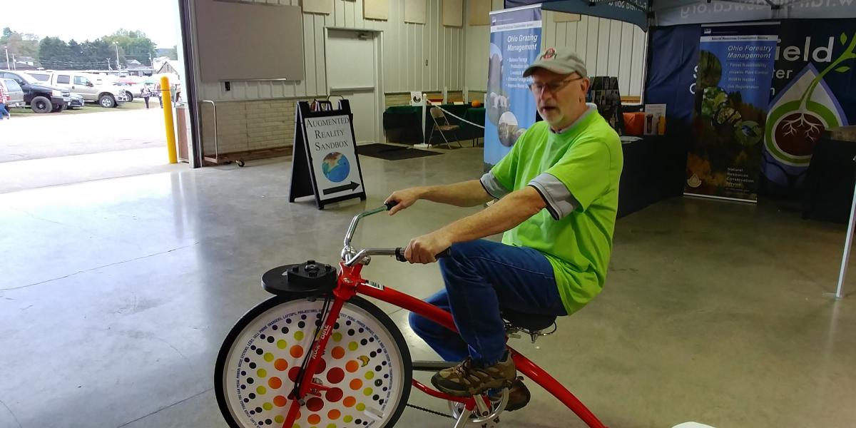 Jerry Iles riding the Smoothie Bike at the Fairfield County Fair