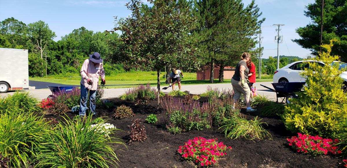 Master Gardener Volunteers working in flowerbeds at the Agriculture Center
