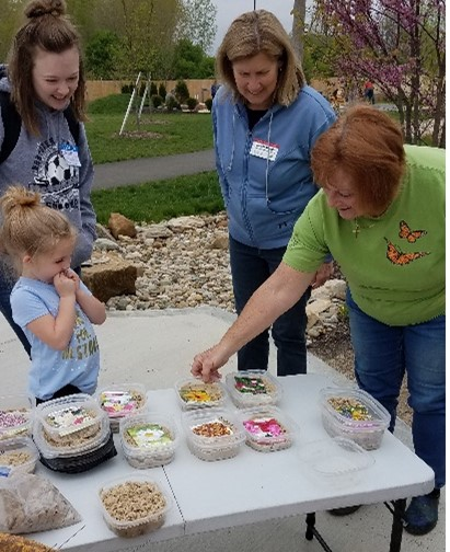 youth and MGV picking seeds for the AHA garden